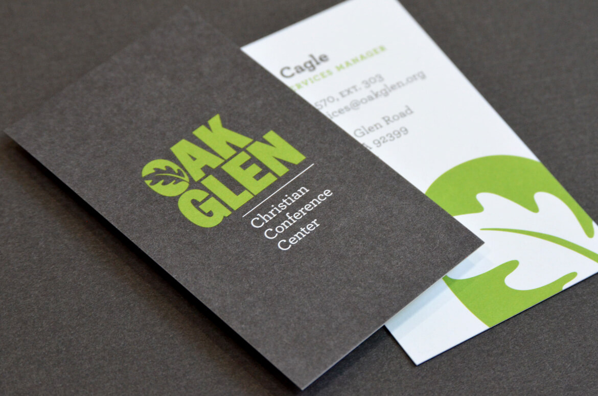 Business cards printed on uncoated paper with green and gray ink.