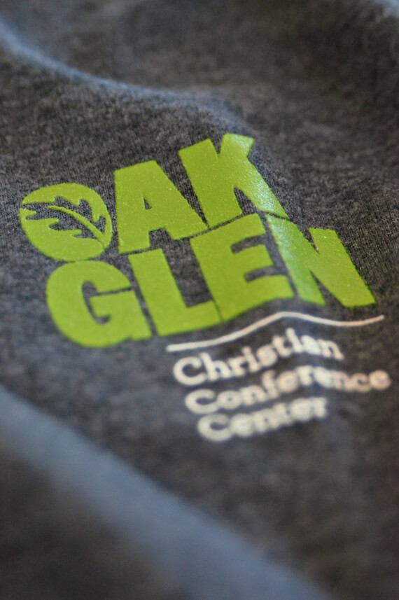 Grey and green T-shirt design for company identity.
