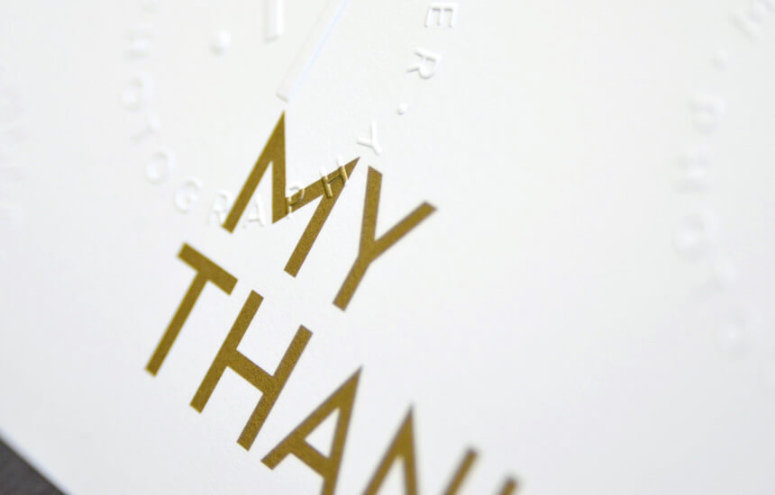 Detail of blind embossing on white stationery.