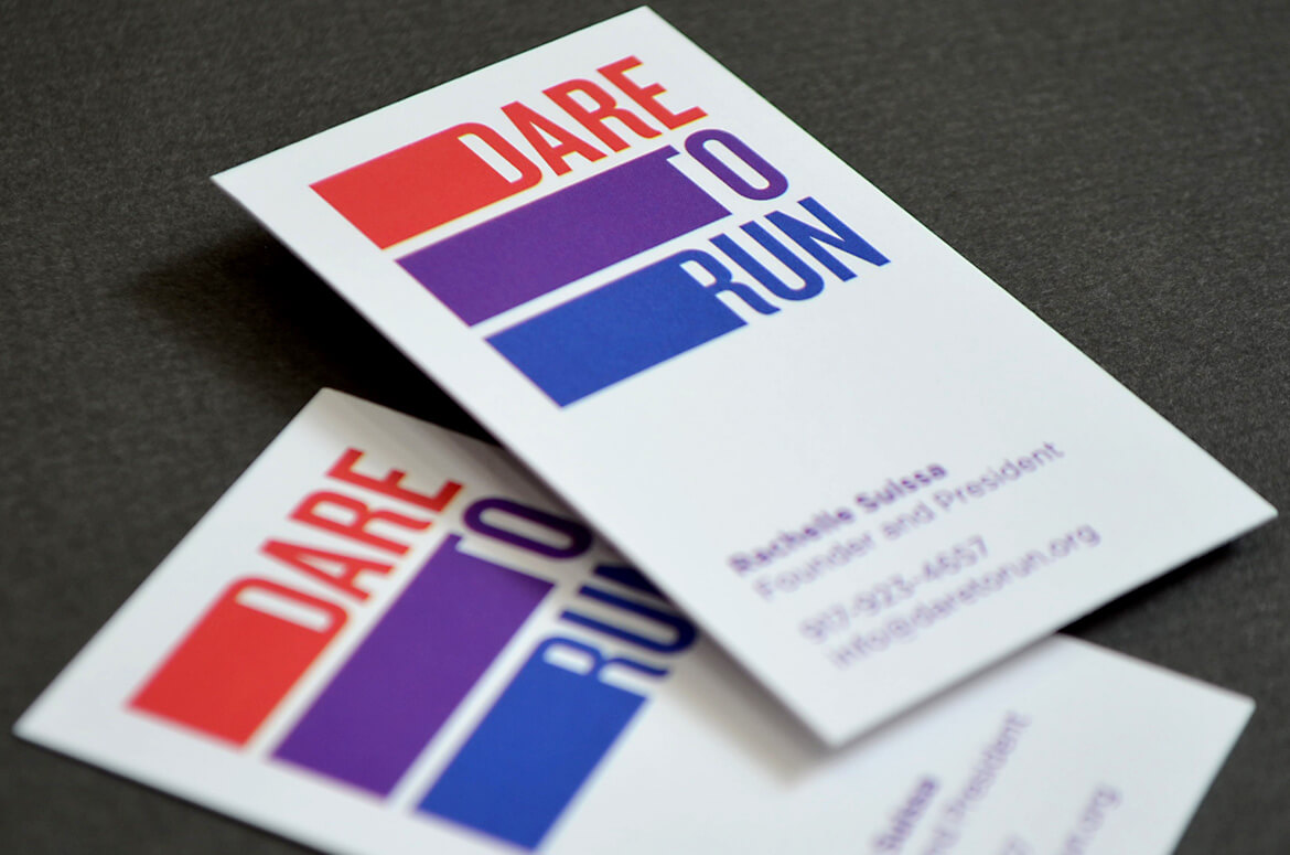 Dare to Run business card with red, purple, and blue striped logo.