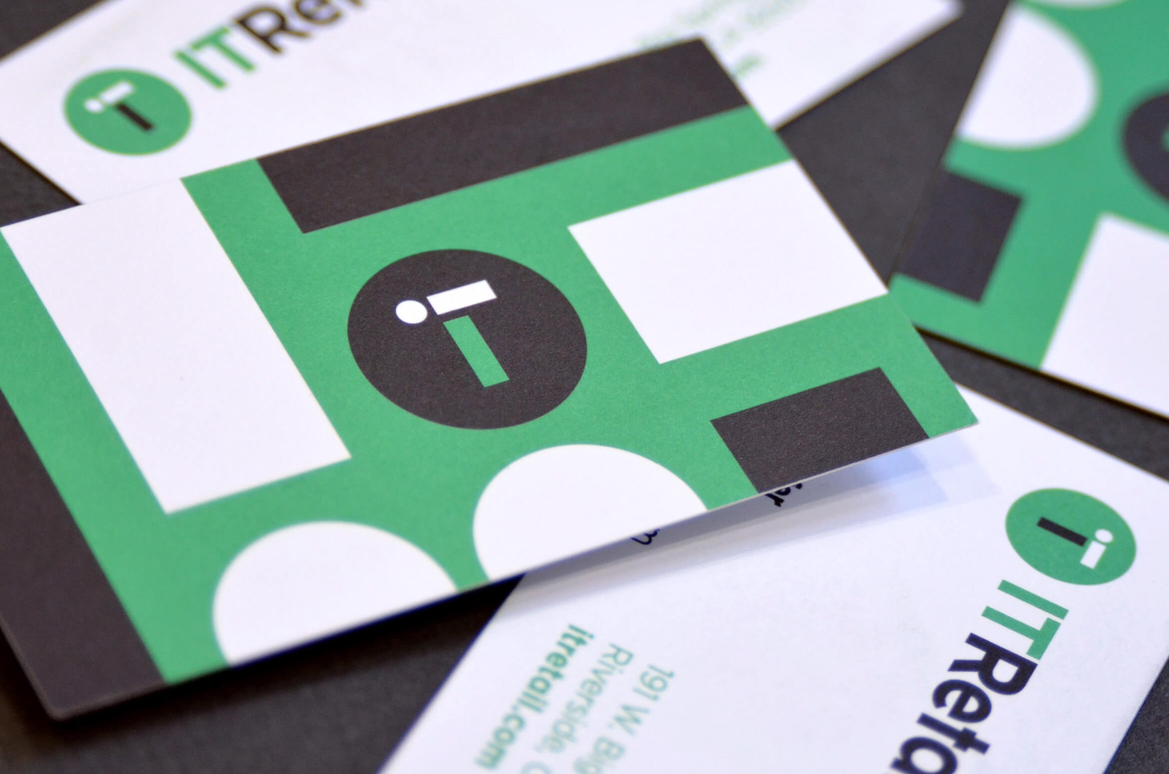 Green and black business cards for IT Retail.