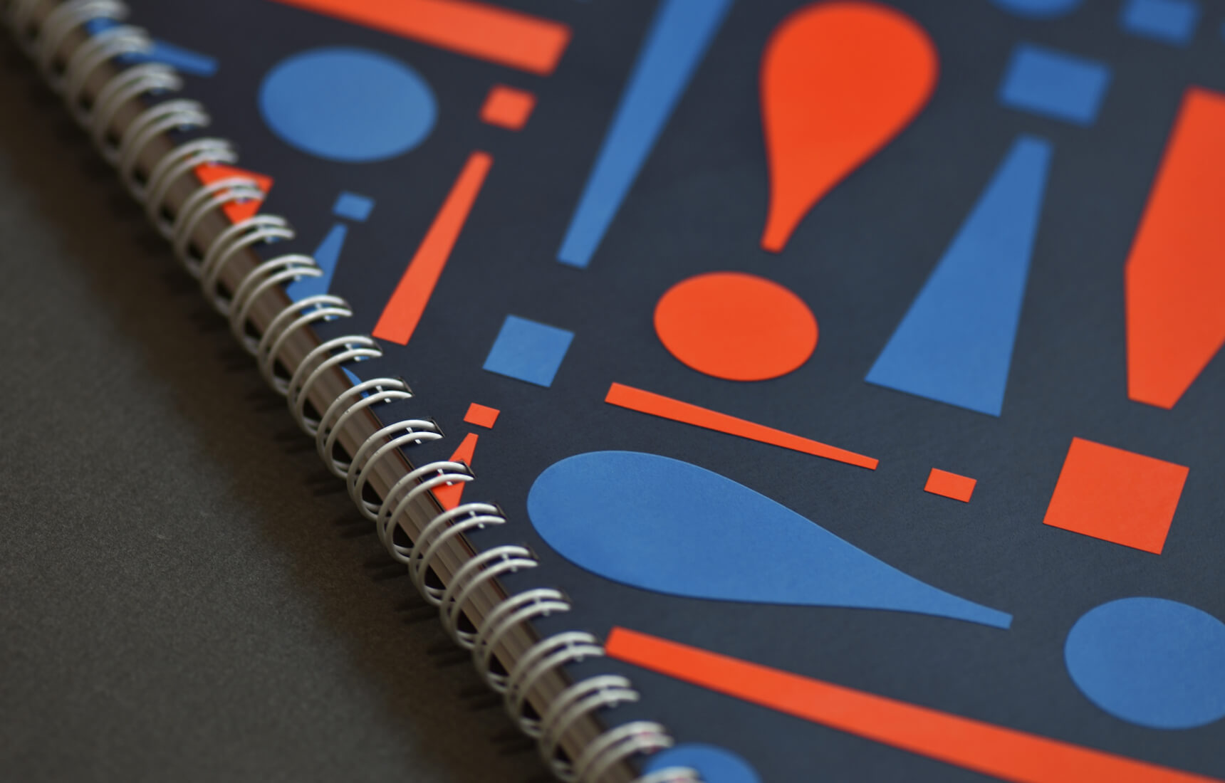 Detail photo of a branded notebook for the National College Training.